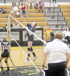 "<div class=""source""></div><div class=""image-desc"">Madeline Morgan spikes the ball over the net.   </div><div class=""buy-pic""><a href=""/photo_select/21555"">Buy this photo</a></div>"