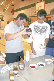 "<div class=""source"">Bryan Marshall</div><div class=""image-desc"">Lee Boone and Austin Caudill make a mega sundae.</div><div class=""buy-pic""><a href=""/photo_select/12811"">Buy this photo</a></div>"