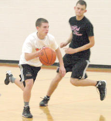 """<div class=""""source""""></div><div class=""""image-desc"""">Brennan Stanley dribbles to the ball to the basket while Chaz Rayburn plays defense.  </div><div class=""""buy-pic""""><a href=""""/photo_select/19369"""">Buy this photo</a></div>"""