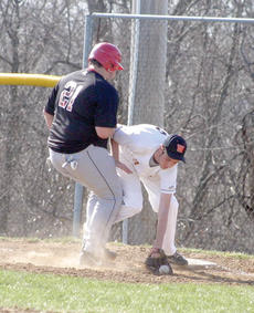 "<div class=""source""></div><div class=""image-desc"">WHS player Austin Jones attempts to tag a runner out during a recent game.</div><div class=""buy-pic""><a href=""http://web2.lcni5.com/cgi-bin/c2newbuyphoto.cgi?pub=195&orig=pic3_93.jpg"" target=""_new"">Buy this photo</a></div>"
