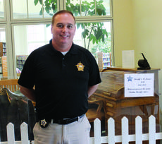 """<div class=""""source""""></div><div class=""""image-desc"""">Grant County Sheriff Chuck Dills poses with some equipment and historical items dating back to the early 1900s. Photos by Amanda Kelly</div><div class=""""buy-pic""""><a href=""""/photo_select/27824"""">Buy this photo</a></div>"""