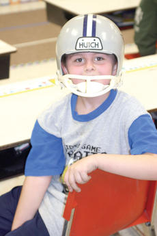 """<div class=""""source""""></div><div class=""""image-desc"""">First grader Dominic Holder wears a helmet to show his dream of being a football player when he gets older.</div><div class=""""buy-pic""""><a href=""""/photo_select/17629"""">Buy this photo</a></div>"""