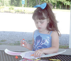"<div class=""source""></div><div class=""image-desc"">Alyssa Redmon works on a project during Little Dippers held at Grant County Park in Crittenden. Photo by Bryan Marshall</div><div class=""buy-pic""><a href=""/photo_select/18190"">Buy this photo</a></div>"