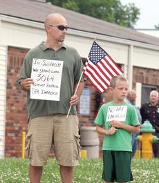"""<div class=""""source""""></div><div class=""""image-desc"""">Dana Corp. employee Buddy Laurent and his son, Mason, hold signs to passersby outside of the Dry Ridge City Building rallying against a payroll tax increase.</div><div class=""""buy-pic""""><a href=""""http://web2.lcni5.com/cgi-bin/c2newbuyphoto.cgi?pub=195&orig=pic4_49.jpg"""" target=""""_new"""">Buy this photo</a></div>"""