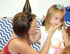 """<div class=""""source"""">Bryan Marshall</div><div class=""""image-desc"""">Sarah Dills wipes off lipstick from her daughter, Bianca, after kissing her goodbye during her first day of kindergarten at Williamstown Elementary.</div><div class=""""buy-pic""""></div>"""