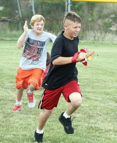"""<div class=""""source"""">Bryan Marshall</div><div class=""""image-desc"""">Williamstown Jr. High sixth grader Brenden Morris chases Jake Huber in a game of capture the flag during Boot Camp.</div><div class=""""buy-pic""""></div>"""
