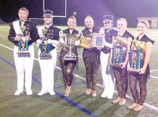 "<div class=""source""></div><div class=""image-desc"">Right: Hannah Riley, Caitlyn Treichel, Jacy Adams, Williamstown band director Chris Hedges, Morgan Shoemaker, Jon Popham, Scott Gettling, Hannah Kiney, Jessica Reynolds and Hunter Groves show off their Grand Champions trophy. </div><div class=""buy-pic""><a href=""/photo_select/19047"">Buy this photo</a></div>"