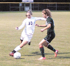"<div class=""source""></div><div class=""image-desc"">Bethany Lawrence kicks the ball away from a defender.</div><div class=""buy-pic""><a href=""http://web2.lcni5.com/cgi-bin/c2newbuyphoto.cgi?pub=195&orig=pic4_64.jpg"" target=""_new"">Buy this photo</a></div>"