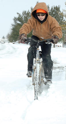 """<div class=""""source""""></div><div class=""""image-desc"""">Corey Hollar didn't let a little snow stop him from riding his bike on Tuesday, Jan. 21 since there was no school. </div><div class=""""buy-pic""""><a href=""""http://web2.lcni5.com/cgi-bin/c2newbuyphoto.cgi?pub=195&orig=pic4_68.jpg"""" target=""""_new"""">Buy this photo</a></div>"""