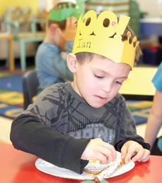 "<div class=""source""></div><div class=""image-desc"">Williamstown Elementary kindergartner Ian Fox decorates his pretzel rod with icing for a 100th day snack.</div><div class=""buy-pic""><a href=""/photo_select/20015"">Buy this photo</a></div>"
