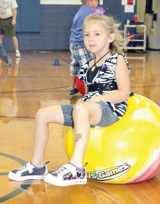 """<div class=""""source""""></div><div class=""""image-desc"""">An incoming CMZ kindergartner bounces on a ball in the gym.</div><div class=""""buy-pic""""><a href=""""/photo_select/21489"""">Buy this photo</a></div>"""