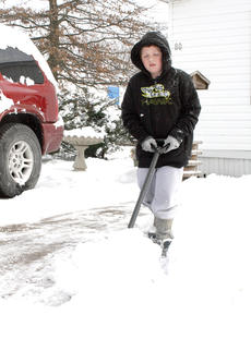 """<div class=""""source""""></div><div class=""""image-desc"""">Brandon Hayes spent his time shoveling his family's driveway in Indian Hill Mobile Home Park. </div><div class=""""buy-pic""""><a href=""""http://web2.lcni5.com/cgi-bin/c2newbuyphoto.cgi?pub=195&orig=pic5_.jpg"""" target=""""_new"""">Buy this photo</a></div>"""