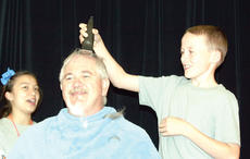 """<div class=""""source""""></div><div class=""""image-desc"""">WHS student Jacob Fryman and WHS Archery coach Mike Walters take turns shaving each other's heads in celebration of advancing to the World Archery Tournament in St. Louis in June. Walters promised the team he would shave his head if they made it to the Worlds. Not only did he keep his promise, but several other students joined in on the head-shaving fun. Photos by Bryan Marshall.</div><div class=""""buy-pic""""><a href=""""http://web2.lcni5.com/cgi-bin/c2newbuyphoto.cgi?pub=195&orig=pic5_25.jpg"""" target=""""_new"""">Buy this photo</a></div>"""