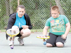 "<div class=""source""></div><div class=""image-desc"">         Grant County Parks and Recreation director Tabatha Clemons gives Wyatt Reed a lesson on controlling the ball with the racket during the Youth Tennis camp at Webb Park in Williamstown. The tennis camp, along with the Start Smart sports fundamental camp, were two new additions to this summer's parks and recreation programs.</div><div class=""buy-pic""><a href=""/photo_select/18318"">Buy this photo</a></div>"