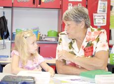 "<div class=""source""></div><div class=""image-desc"">Barb Eldridge tells her granddaughter, Addyson Cleveland, a story during CMZ's Grandparent's Day.</div><div class=""buy-pic""><a href=""/photo_select/19178"">Buy this photo</a></div>"