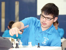 """<div class=""""source""""></div><div class=""""image-desc"""">Grant County Chess Team member Dylan Strong attempts to make the right move.</div><div class=""""buy-pic""""><a href=""""/photo_select/20095"""">Buy this photo</a></div>"""