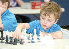 """<div class=""""source""""></div><div class=""""image-desc"""">Ivan Vie Brooks of the Grant County Chess Team makes his move during the Kay Hughett Chess Tournament. Photos by Bryan Marshall</div><div class=""""buy-pic""""><a href=""""/photo_select/20094"""">Buy this photo</a></div>"""
