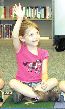 """<div class=""""source""""></div><div class=""""image-desc"""">Kaydence Covington raises her hand to answer a question in CMZ's music room.</div><div class=""""buy-pic""""><a href=""""/photo_select/21491"""">Buy this photo</a></div>"""