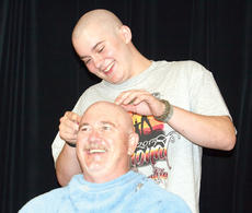 """<div class=""""source""""></div><div class=""""image-desc"""">WHS archer Brennon Osborne takes his turn at shaving part of Mike Walters head. Each team member got to take a swipe of hair off with the clippers, starting with the top 12 scorers in the National Archery Tournament. </div><div class=""""buy-pic""""><a href=""""http://web2.lcni5.com/cgi-bin/c2newbuyphoto.cgi?pub=195&orig=pic7_30.jpg"""" target=""""_new"""">Buy this photo</a></div>"""