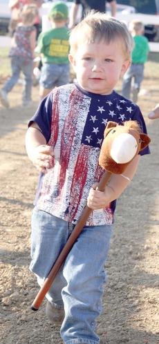 "<div class=""source""></div><div class=""image-desc"">FAIR FUN - Levi Wolfe tries to beat the other competitors in the stick horse race during the Kids Day games at the Grant County Fair at the Northern Kentucky Fairgrounds in Williamstown. Photo by Bryan Marshall</div><div class=""buy-pic""><a href=""http://web2.lcni5.com/cgi-bin/c2newbuyphoto.cgi?pub=195&orig=pic7_35.jpg"" target=""_new"">Buy this photo</a></div>"