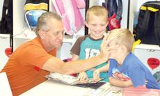 "<div class=""source""></div><div class=""image-desc"">Grandpa Mike jokes around with Owen Clark and Marcus Draper at Crittenden-Mt. Zion Elementary's Grandparent's Day.</div><div class=""buy-pic""><a href=""/photo_select/19177"">Buy this photo</a></div>"