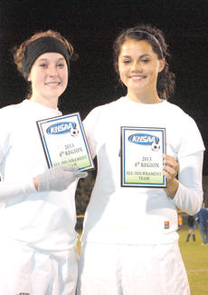 "<div class=""source""></div><div class=""image-desc"">Mollie Pelfrey, left, and Alicia Moreno, right, were named to the 2013 8th Region All-Tournament team.</div><div class=""buy-pic""><a href=""http://web2.lcni5.com/cgi-bin/c2newbuyphoto.cgi?pub=195&orig=pic7_41.jpg"" target=""_new"">Buy this photo</a></div>"