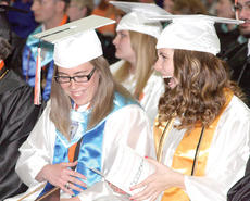 "<div class=""source""></div><div class=""image-desc"">Williamstown High School seniors Olivia Chandler and Andrea Carter share a laugh during the graduation ceremony. Photo by Bryan Marshall</div><div class=""buy-pic""><a href=""/photo_select/18037"">Buy this photo</a></div>"