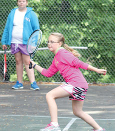 "<div class=""source""></div><div class=""image-desc"">Claudia Spratt reaches with her racket to make contact with the tennis ball.</div><div class=""buy-pic""><a href=""/photo_select/18320"">Buy this photo</a></div>"