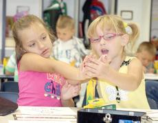 """<div class=""""source"""">Bryan Marshall</div><div class=""""image-desc""""> Crittenden-Mt.Zion Elementary kindergartners Madison Utter and Danika King have fun during the first day.</div><div class=""""buy-pic""""></div>"""