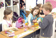 """<div class=""""source""""></div><div class=""""image-desc"""">Alyssa Sargent and Jaclyne Northcutt explain the medical booth to Corey Wood in a first grade project.CMZ kindergartner William Walker pets a scaly friend brought by a representative of the Newport Aquarium for Career Week. Photos by Bryan Marshall</div><div class=""""buy-pic""""><a href=""""/photo_select/17630"""">Buy this photo</a></div>"""