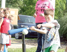 "<div class=""source""></div><div class=""image-desc"">Archie Zeiser keeps his eye on the ball as he smashes it off the tee during the Start Smart sports fundamentals camp at the Grant County Park in Crittenden</div><div class=""buy-pic""><a href=""/photo_select/18322"">Buy this photo</a></div>"