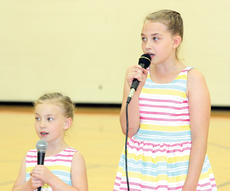 """<div class=""""source""""></div><div class=""""image-desc"""">Sisters Avery and Rylie King sing their way to a third-place finish at the WES Talent Show.</div><div class=""""buy-pic""""><a href=""""http://web2.lcni5.com/cgi-bin/c2newbuyphoto.cgi?pub=195&orig=pic9_30.jpg"""" target=""""_new"""">Buy this photo</a></div>"""