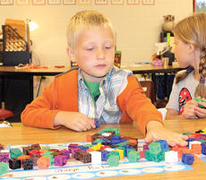 "<div class=""source""></div><div class=""image-desc"">Williamstown Elementary kindergartner LaBryce Holleran sorts through blocks during the first day of school. Photos by Bryan Marshall</div><div class=""buy-pic""><a href=""/photo_select/21521"">Buy this photo</a></div>"