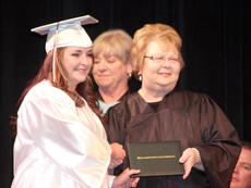 "<div class=""source""></div><div class=""image-desc"">Former Williamstown Independent School Board member Connie Lawrence presented a WHS senior with her diploma during the 2015 graduation ceremony. Lawrence died July 6. File photo</div><div class=""buy-pic""><a href=""/photo_select/26903"">Buy this photo</a></div>"