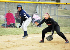 """<div class=""""source""""></div><div class=""""image-desc"""">Bailey Bruce attempts to steal third base as a Harrison County Fillie is ready for the ball. The Grant County Lady Braves tied the game 8-8 with the Harrison County Fillies. Photos by Camille McClanahan</div><div class=""""buy-pic""""><a href=""""/photo_select/20241"""">Buy this photo</a></div>"""