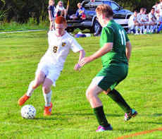 "<div class=""source""></div><div class=""image-desc"">Austin Creech tries to maneuver around a Covington Latin player. </div><div class=""buy-pic""><a href=""/photo_select/27437"">Buy this photo</a></div>"