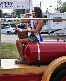 "<div class=""source""></div><div class=""image-desc"">Haley Spillman, 2013 Miss Grant County throws candy  </div><div class=""buy-pic""><a href=""/photo_select/18847"">Buy this photo</a></div>"