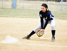 """<div class=""""source""""></div><div class=""""image-desc"""">Kaitlyn Kinman catches the ball on the pitchers mound.    </div><div class=""""buy-pic""""><a href=""""/photo_select/20236"""">Buy this photo</a></div>"""