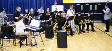 """<div class=""""source""""></div><div class=""""image-desc"""">The Grant County Jazz Band performs during Grant County Middle School's second annual Arts Night.  Photos by Mark Verbeck </div><div class=""""buy-pic""""><a href=""""http://web2.lcni5.com/cgi-bin/c2newbuyphoto.cgi?pub=195&orig=pic_1_51.jpg"""" target=""""_new"""">Buy this photo</a></div>"""