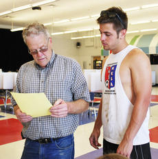 "<div class=""source""></div><div class=""image-desc"">Ed Feldman shows his son, Eddie Feldman, a precinct sheet at the Williamstown High School on May 20. Photo by Camille McClanahan </div><div class=""buy-pic""><a href=""/photo_select/20739"">Buy this photo</a></div>"