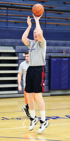 """<div class=""""source""""></div><div class=""""image-desc"""">Grant County Middle School Principal John Preston attempts to shoot the ball. Preston was also named the games MVP. </div><div class=""""buy-pic""""><a href=""""/photo_select/20751"""">Buy this photo</a></div>"""