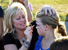 """<div class=""""source""""></div><div class=""""image-desc"""">Lauri Ford, a kindergarten teacher, puts a face on Paige Lonkard, a fourth grader, during DRE's Fall Fest</div><div class=""""buy-pic""""><a href=""""/photo_select/19011"""">Buy this photo</a></div>"""