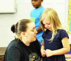 "<div class=""source""></div><div class=""image-desc"">Brittany Bock consoles DRE kindergartner Jillian Treadway on the first day of school </div><div class=""buy-pic""><a href=""http://web2.lcni5.com/cgi-bin/c2newbuyphoto.cgi?pub=195&orig=pic_1_82.jpg"" target=""_new"">Buy this photo</a></div>"