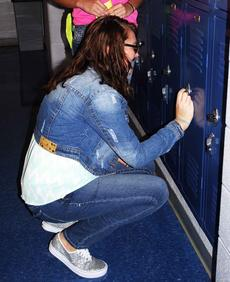 "<div class=""source""></div><div class=""image-desc""> Grant County High School student Brianna Schwartz opens her locker between classes.</div><div class=""buy-pic""><a href=""http://web2.lcni5.com/cgi-bin/c2newbuyphoto.cgi?pub=195&orig=pic_1_83.jpg"" target=""_new"">Buy this photo</a></div>"
