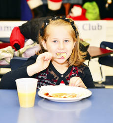 """<div class=""""source"""">Mark Verbeck, Photographer</div><div class=""""image-desc"""">Jaylynn Best enjoys pancakes on Dec. 5 during the annual free Kiwanis Pancakes With Santa.</div><div class=""""buy-pic""""><a href=""""/photo_select/23768"""">Buy this photo</a></div>"""