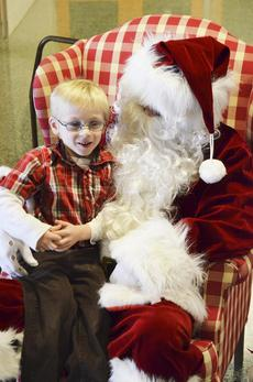 "<div class=""source""></div><div class=""image-desc"">Jackson Maines tells Santa he will elave milk and cookies at his house. </div><div class=""buy-pic""><a href=""http://web2.lcni5.com/cgi-bin/c2newbuyphoto.cgi?pub=195&orig=pic_2_24.jpg"" target=""_new"">Buy this photo</a></div>"