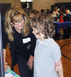 "<div class=""source""></div><div class=""image-desc"">Kurt Perleberg asks Melissa Angell, a pharmacist, questions about her career at the Career Expo held at Mason-Corinth Elementary. </div><div class=""buy-pic""><a href=""/photo_select/19330"">Buy this photo</a></div>"