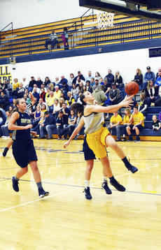 """<div class=""""source""""></div><div class=""""image-desc"""">Jenna Martin goes for a lay up at the Braves Madness girls basketball game. </div><div class=""""buy-pic""""><a href=""""/photo_select/19412"""">Buy this photo</a></div>"""