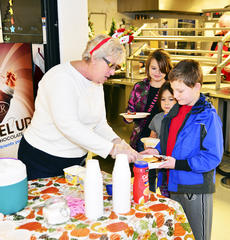 """<div class=""""source"""">Mark Verbeck, Photographer</div><div class=""""image-desc"""">Linda Dunn, serves during the event. Children were also treated to a play sponsored by the Grant County Chamber of Commerce in the afternoon.  Photos by Mark Verbeck </div><div class=""""buy-pic""""><a href=""""/photo_select/23770"""">Buy this photo</a></div>"""