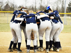 """<div class=""""source""""></div><div class=""""image-desc"""">The Grant County Braves gather for support before they play softball. </div><div class=""""buy-pic""""><a href=""""/photo_select/20237"""">Buy this photo</a></div>"""